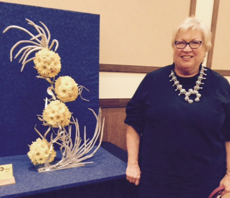 Beth showing her arrangement depicting movie 'Space Balls' at AFGC AZ state convention April 2015 in Yuma